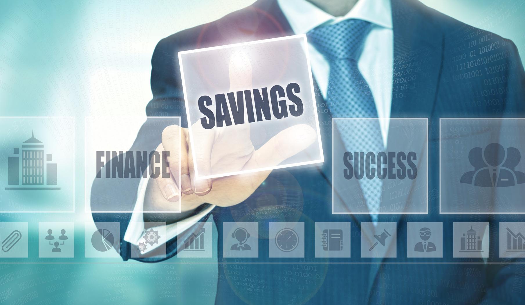 Businessman pressing an Savings concept button.
